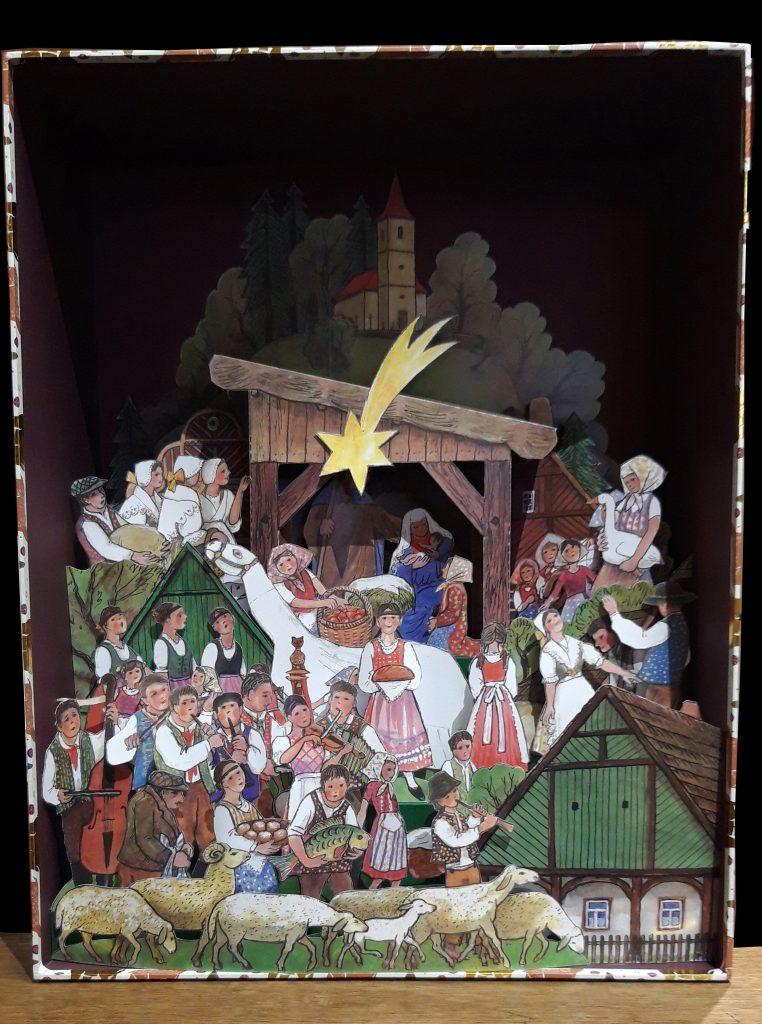 """Papierkrippe entworfen vom Künstler Jiri Skopek, erschien im Konrad-Verlag unter dem Titel """"Skopek – Folkloristische Weihnachtskrippe""""."""